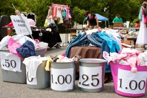 Buckets of Items With Prices On Display at Garage Sale